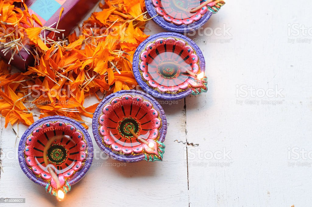 diya lamps lit during diwali celebration with flowers and sweets stock photo
