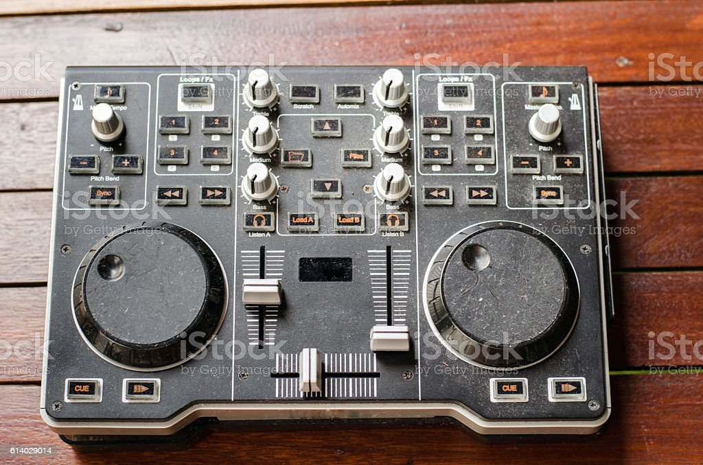Dj Controller old, on with table wood. stock photo