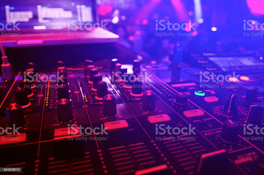Dj desk close up with blue and  pink lights stock photo