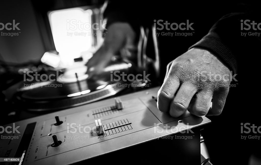 Dj in studio with turntable and mixer stock photo