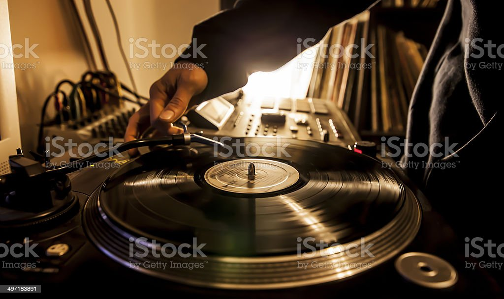 Dj in studio with turntable stock photo