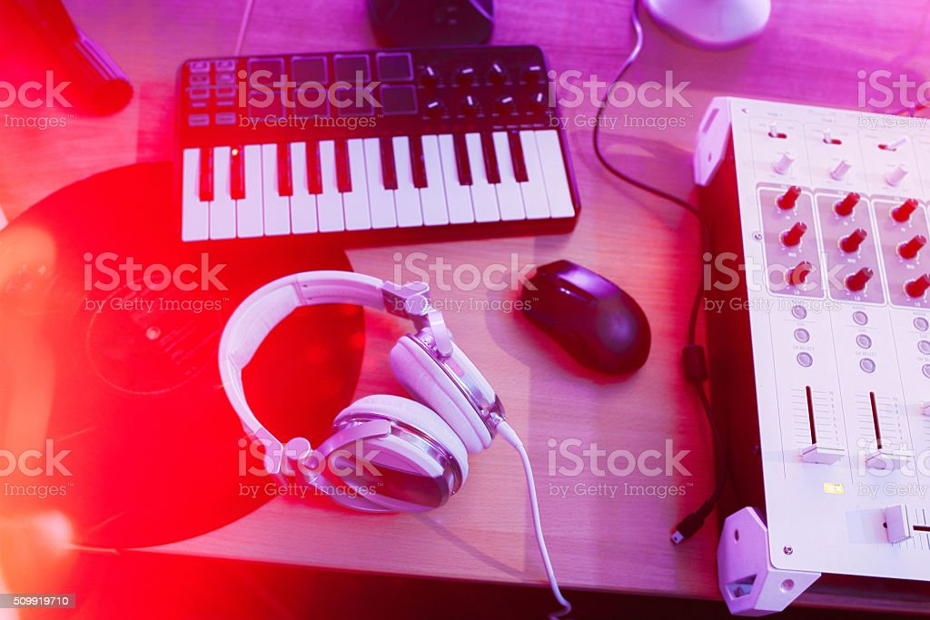 Dj mixer with headphones and synthesizer stock photo