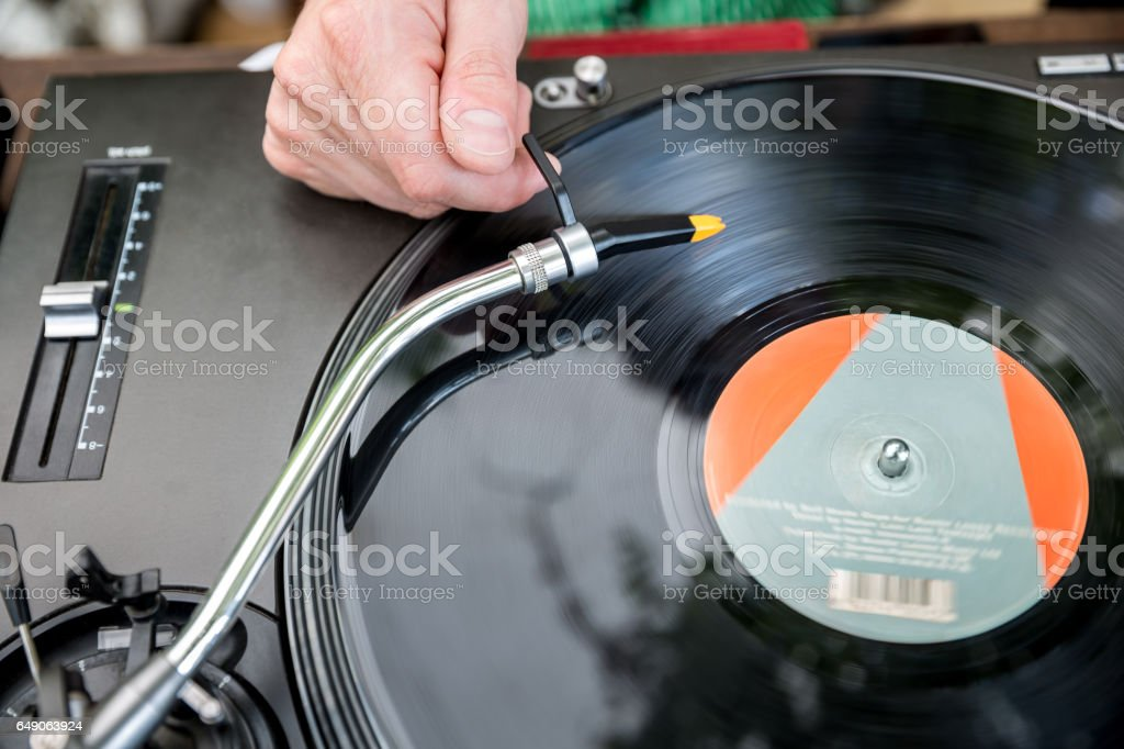 Dj mixes the track in club stock photo