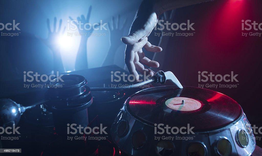 Dj playing on vinyl royalty-free stock photo