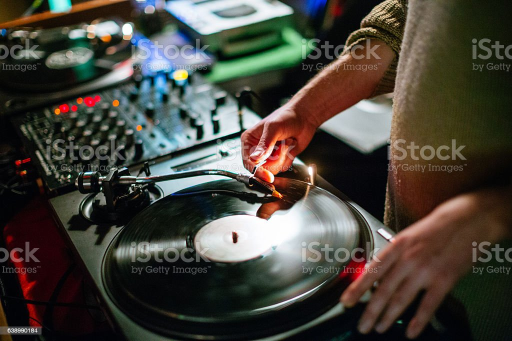 Dj playing vinyl on a party stock photo