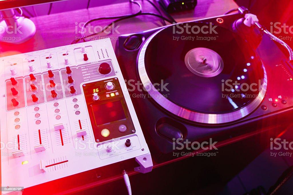 Dj vinyl player and mixer in studio stock photo