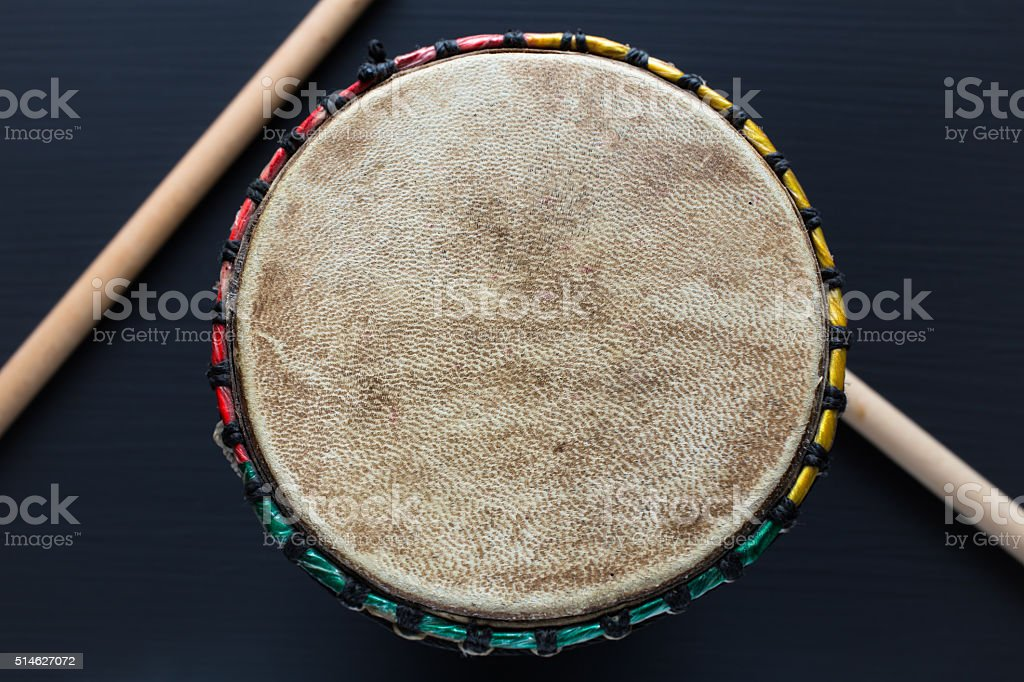 Djembe with drum sticks - Top view stock photo