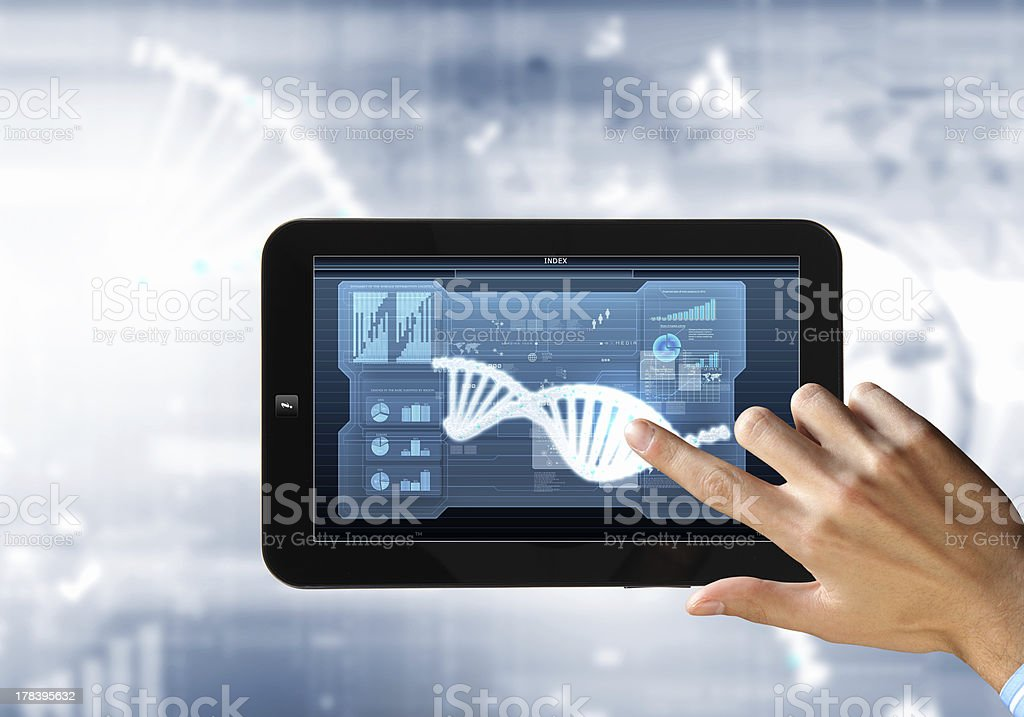 Dna strand On The Tablet Screen royalty-free stock photo