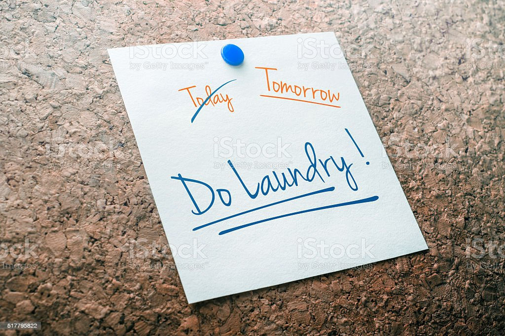 Do Laundry Reminder For Tomorrow With Crossed Out Today stock photo