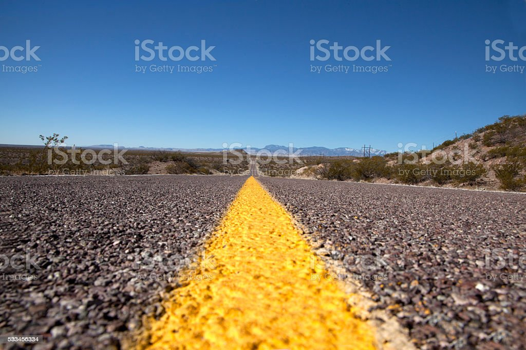 Do not cross yellow line on road stock photo