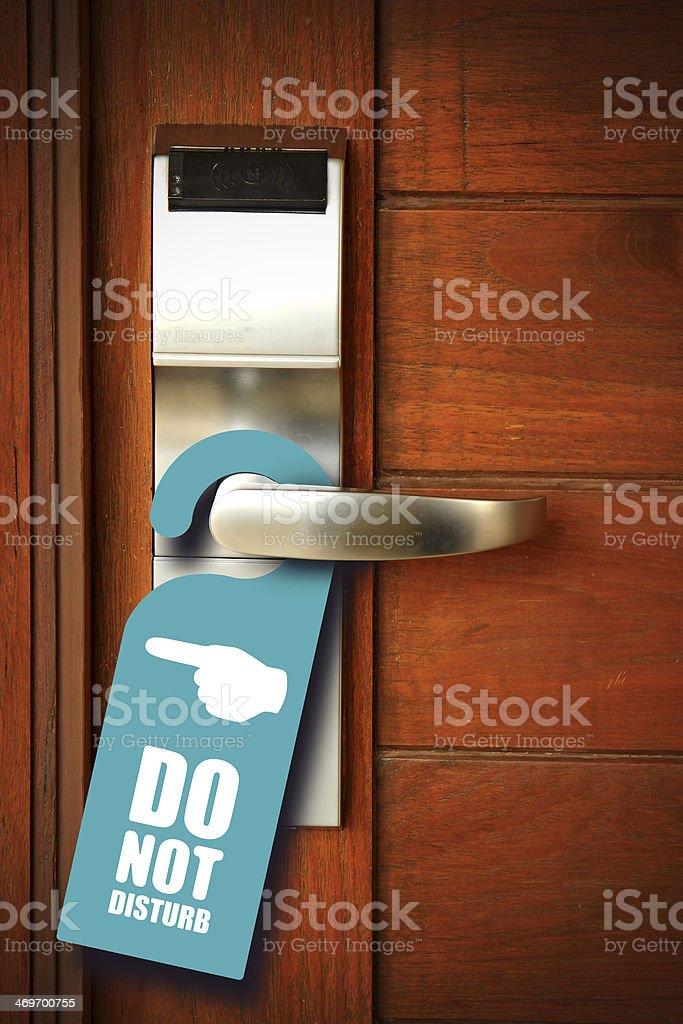 Do not disturb sign hang on door knob stock photo