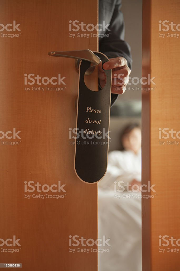 'Do not disturb' sign on a hotel room door stock photo