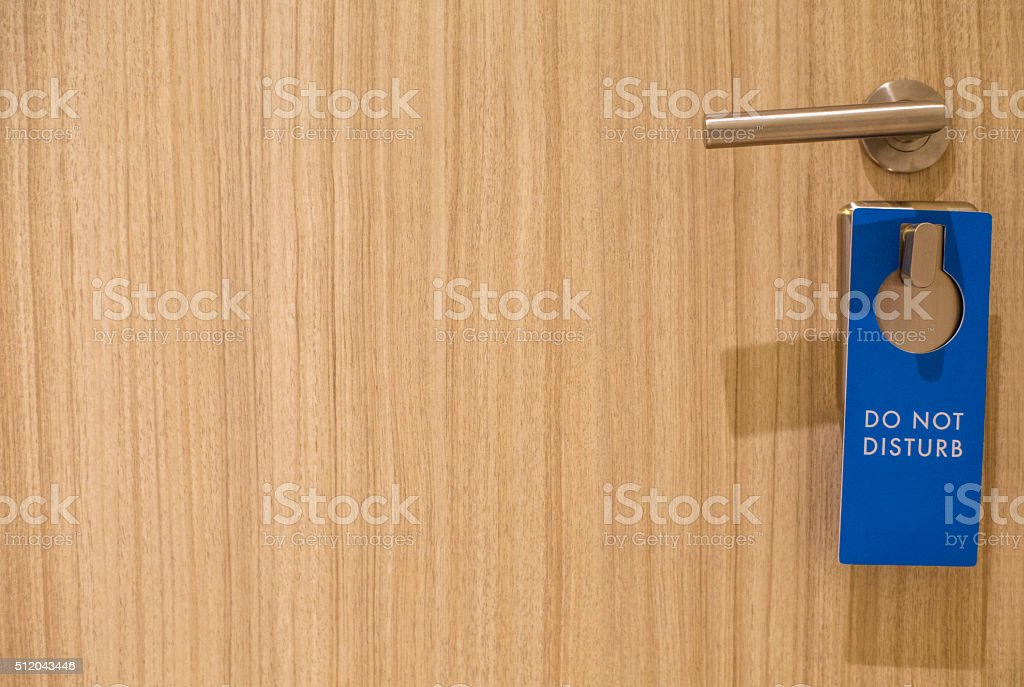'do not disturb' tag hanging on the door knob stock photo