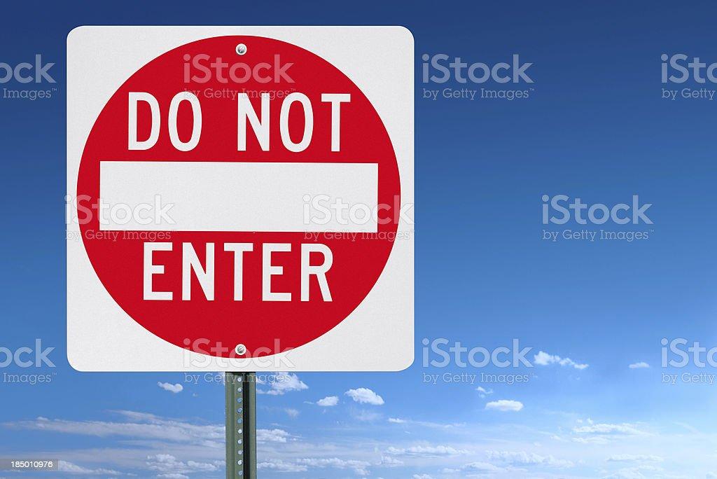 Do Not Enter Sign Post Over a Blue Sky stock photo