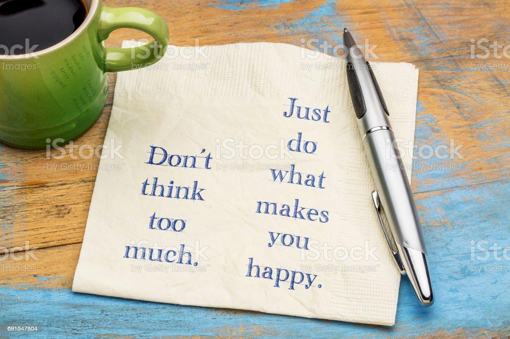 Do not think too much ... inspiraitonal text on napkin stock photo