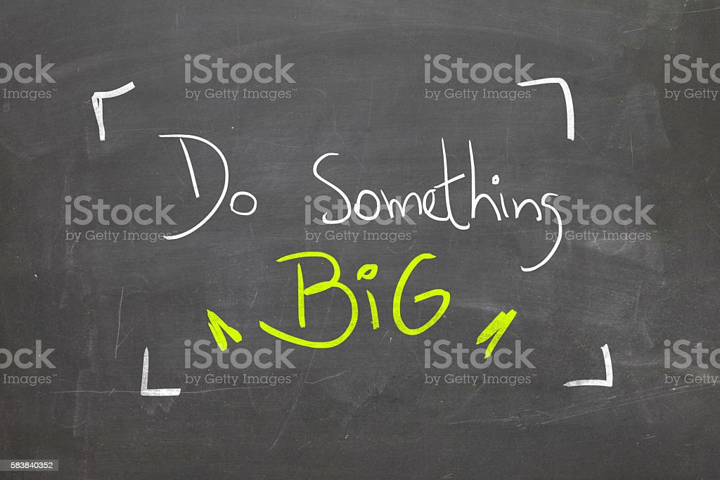 Do something big written on blackboard stock photo