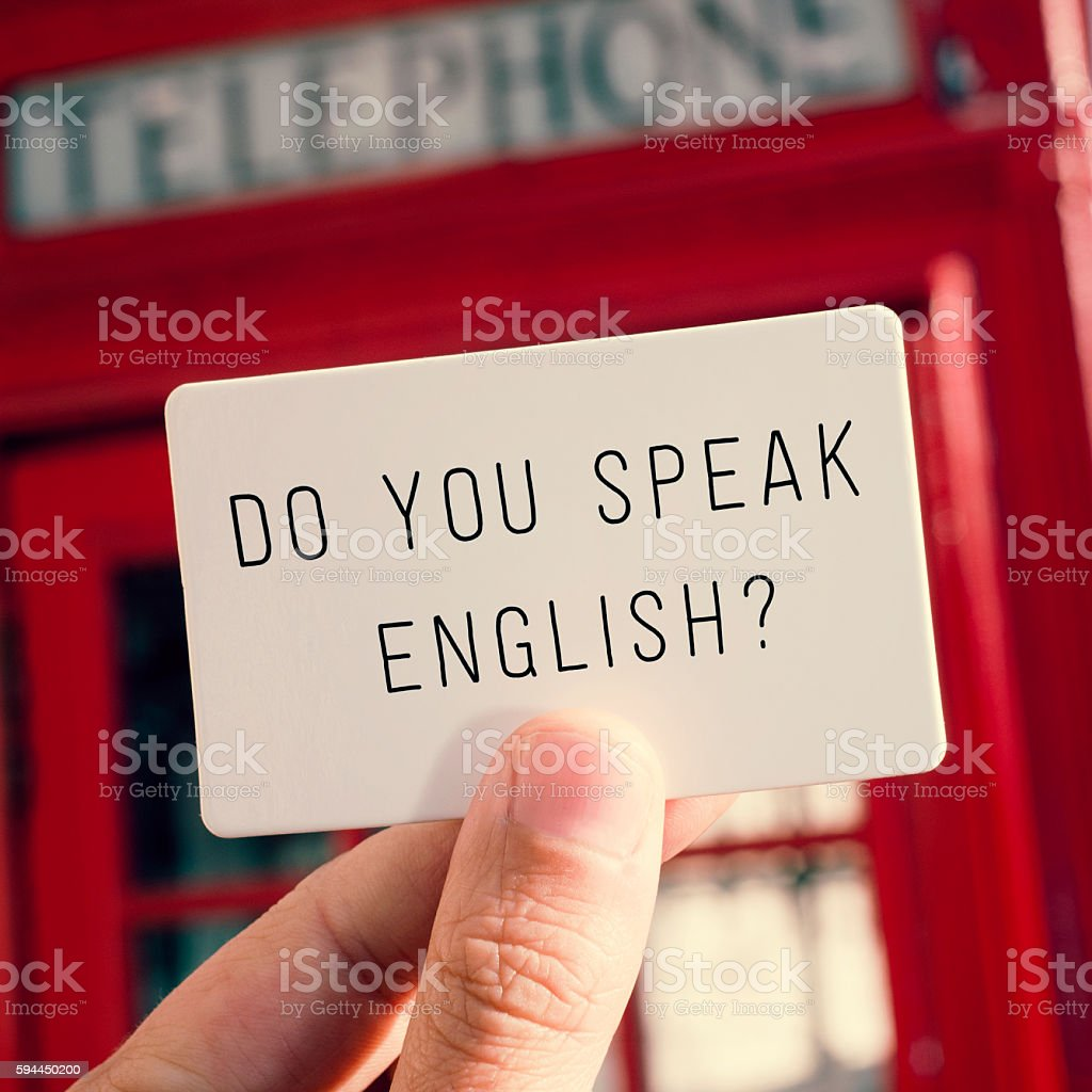 do you speak english? in a signboard stock photo