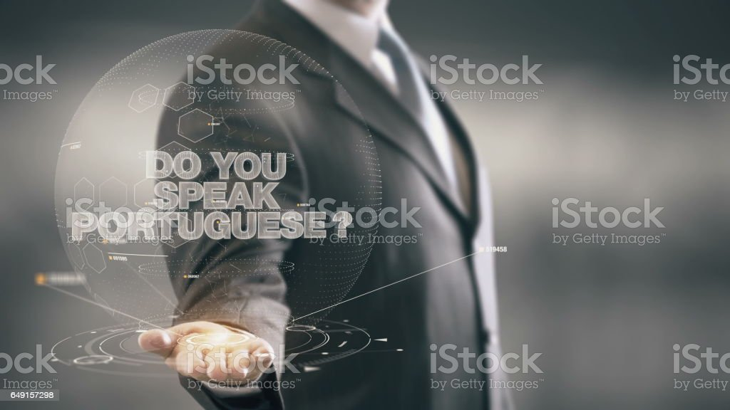 Do Your Speak Portuguese Businessman Holding in Hand New technologies stock photo