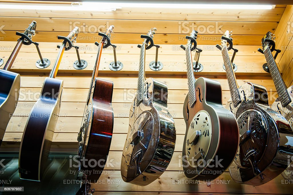 Dobro guitars collection in store stock photo