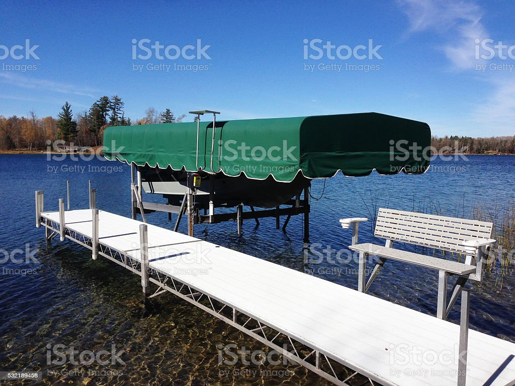 Dock and Boat Lift on Lake stock photo