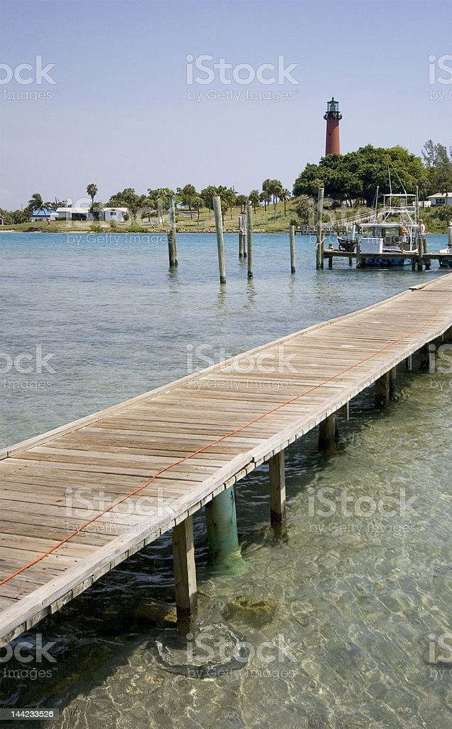 Dock and Lighthouse royalty-free stock photo
