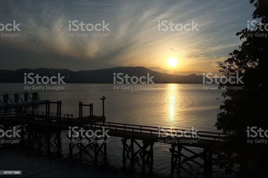 Dock at sunset stock photo