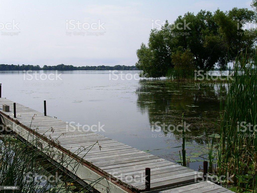 Dock by a calm lake royalty-free stock photo