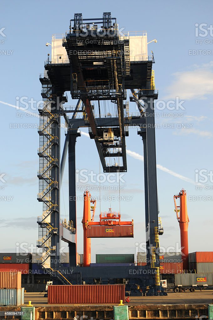 dock crane loading cargo container onto ship, Cristobal, Panama royalty-free stock photo