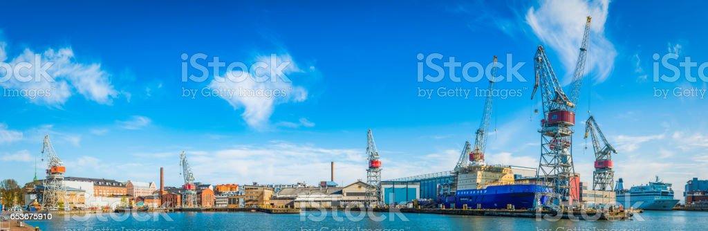 Dock cranes ferries icebreakers working harbour panorama Helsinki Finland stock photo