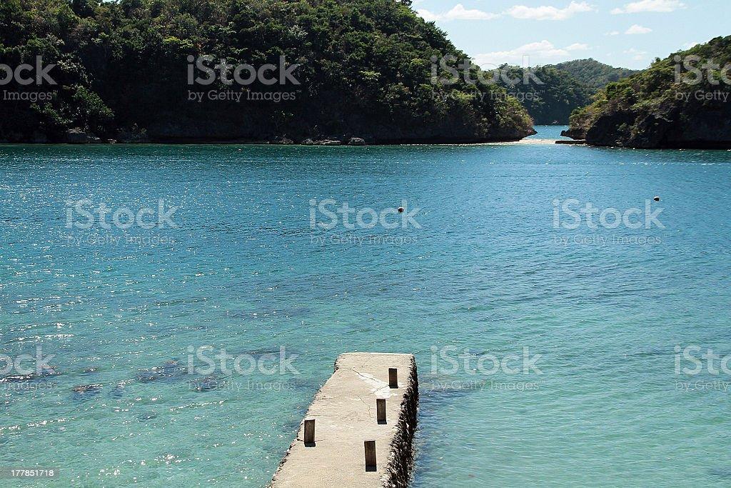 Dock ammirando isole tropicali foto stock royalty-free