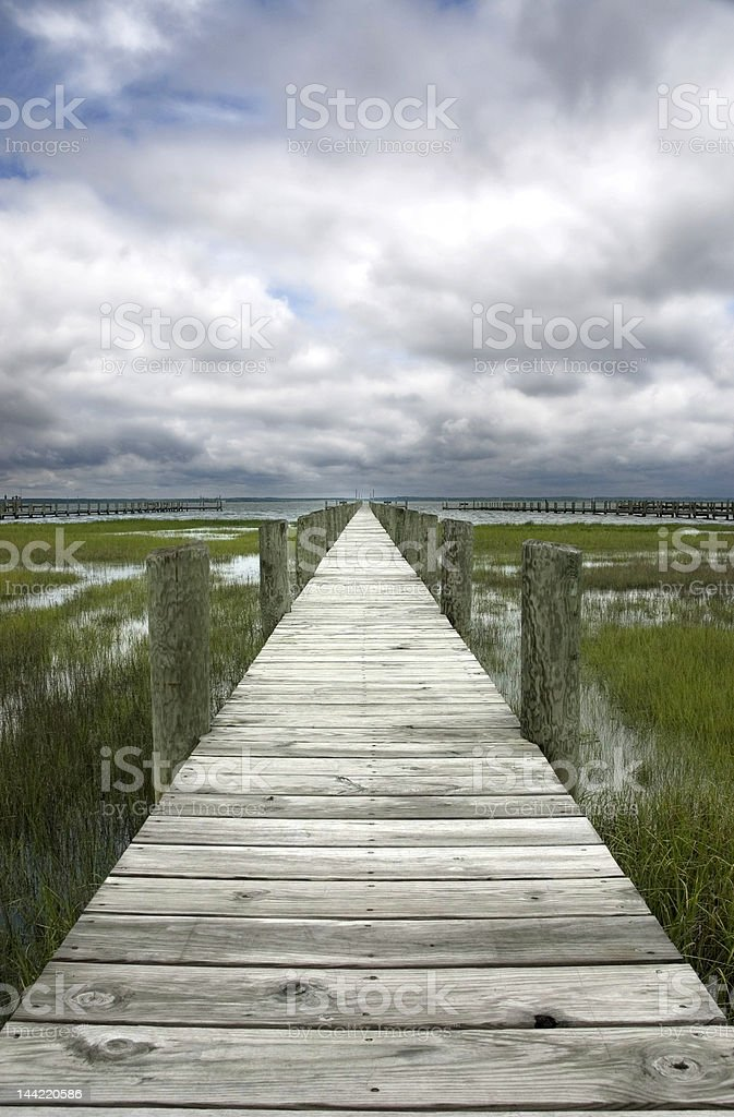 Dock on a cloudy day royalty-free stock photo