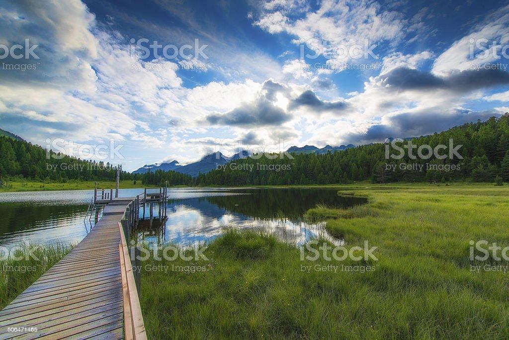 dock on mountain lake stock photo