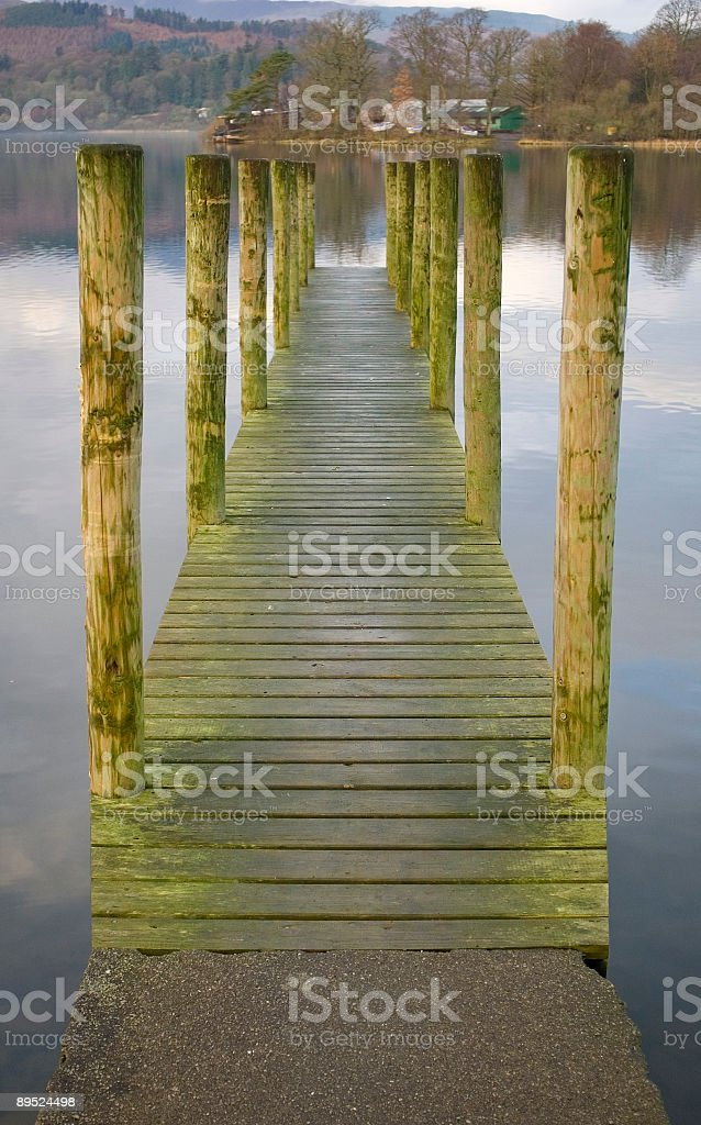 Dock on tranquil lake royalty-free stock photo
