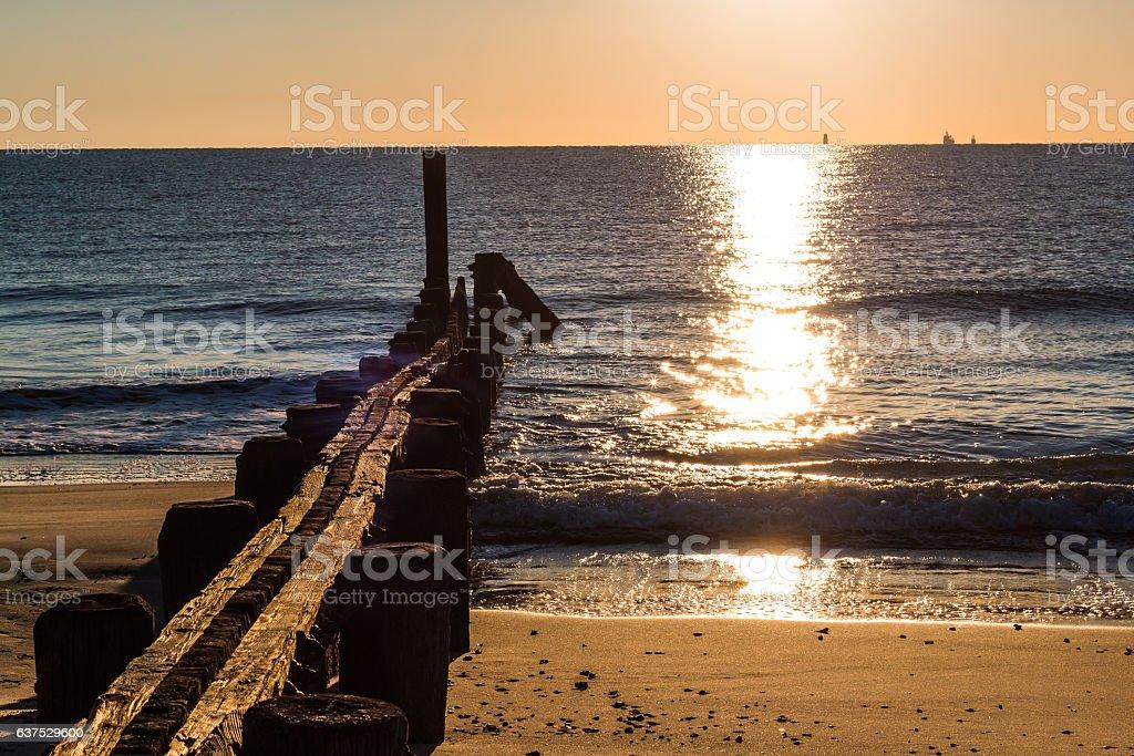 Dock Pilings at Sunrise at Buckroe Beach stock photo