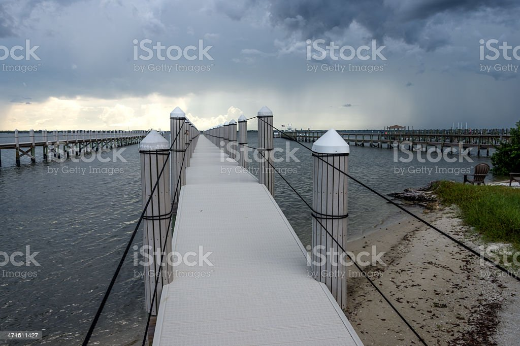 Dock With Approaching Storm stock photo