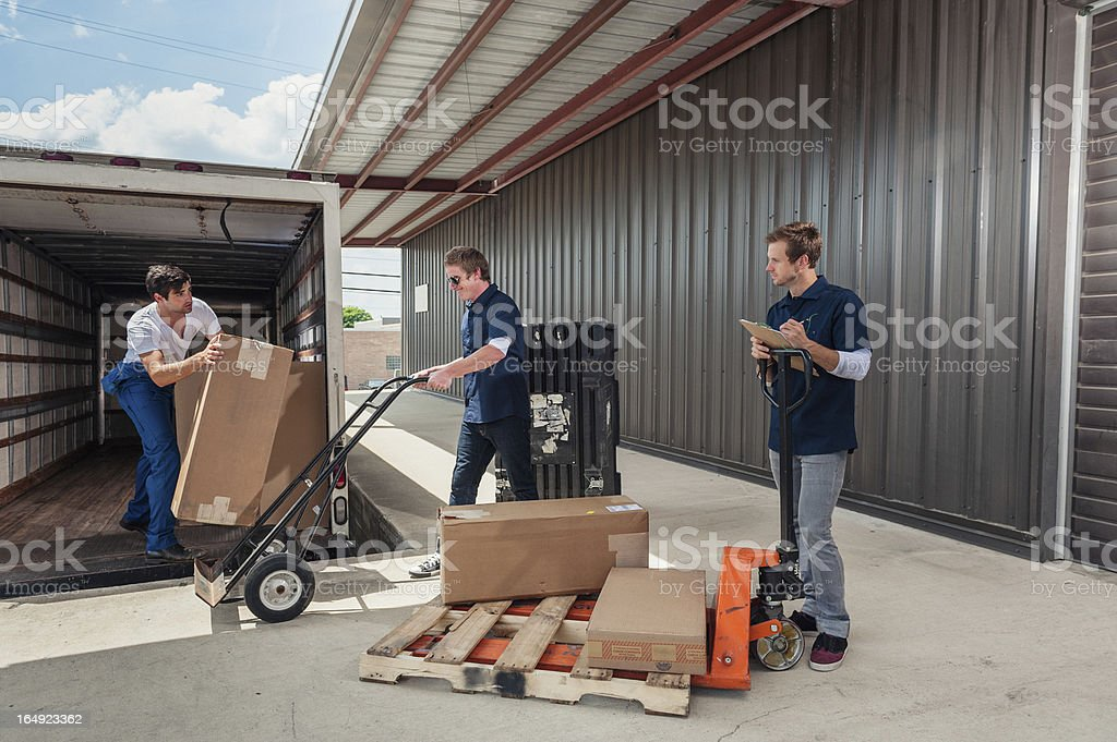Dock Workers Loading A Delivery Truck stock photo