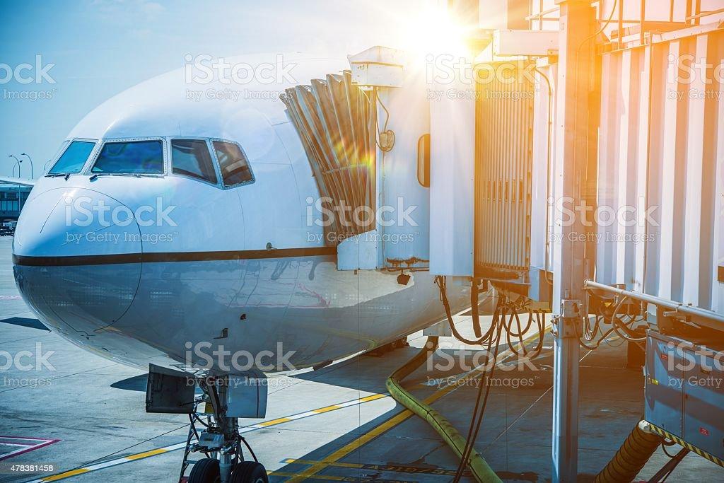 Docked Airplane Jet Bridge stock photo