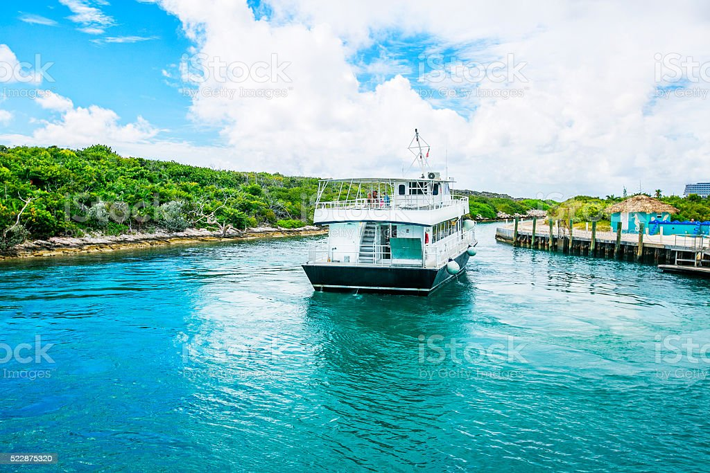 Docked boat at Half Moon Cay in the Bahamas. stock photo