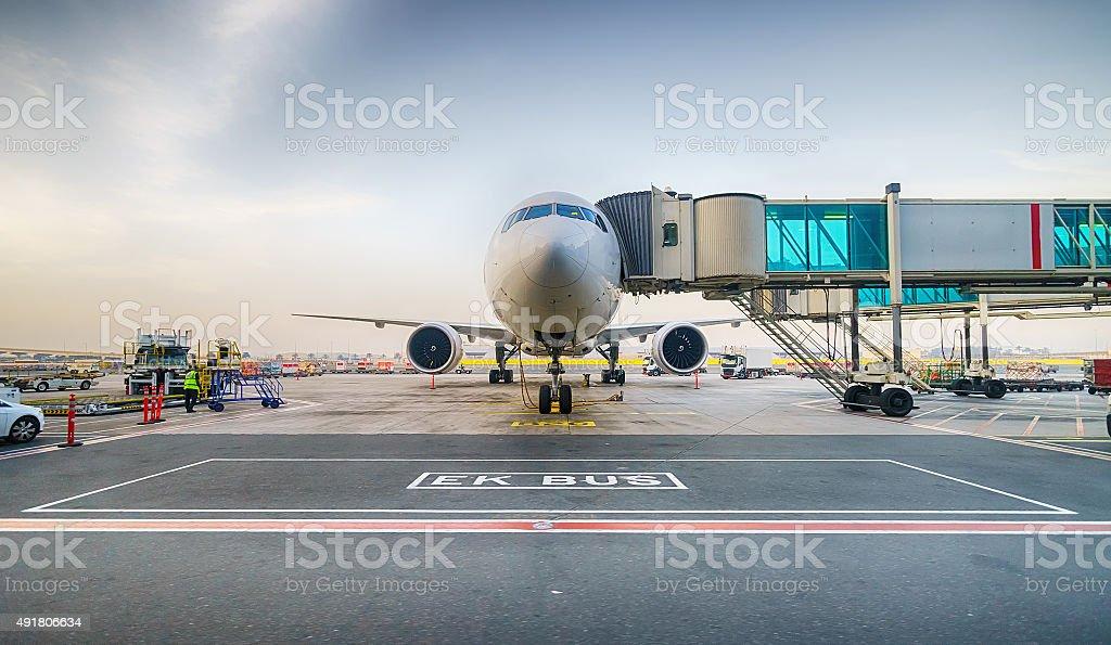 Docked jet aircraft in Dubai airport stock photo