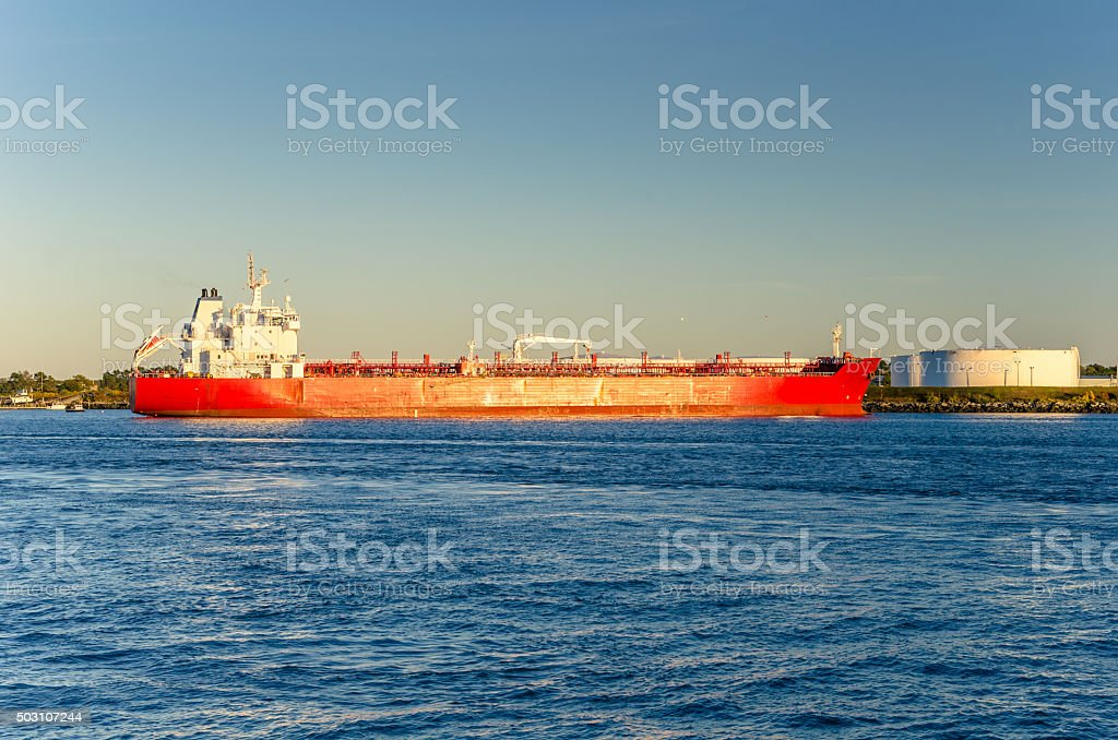 Docked Oil Tanker at Sunset stock photo