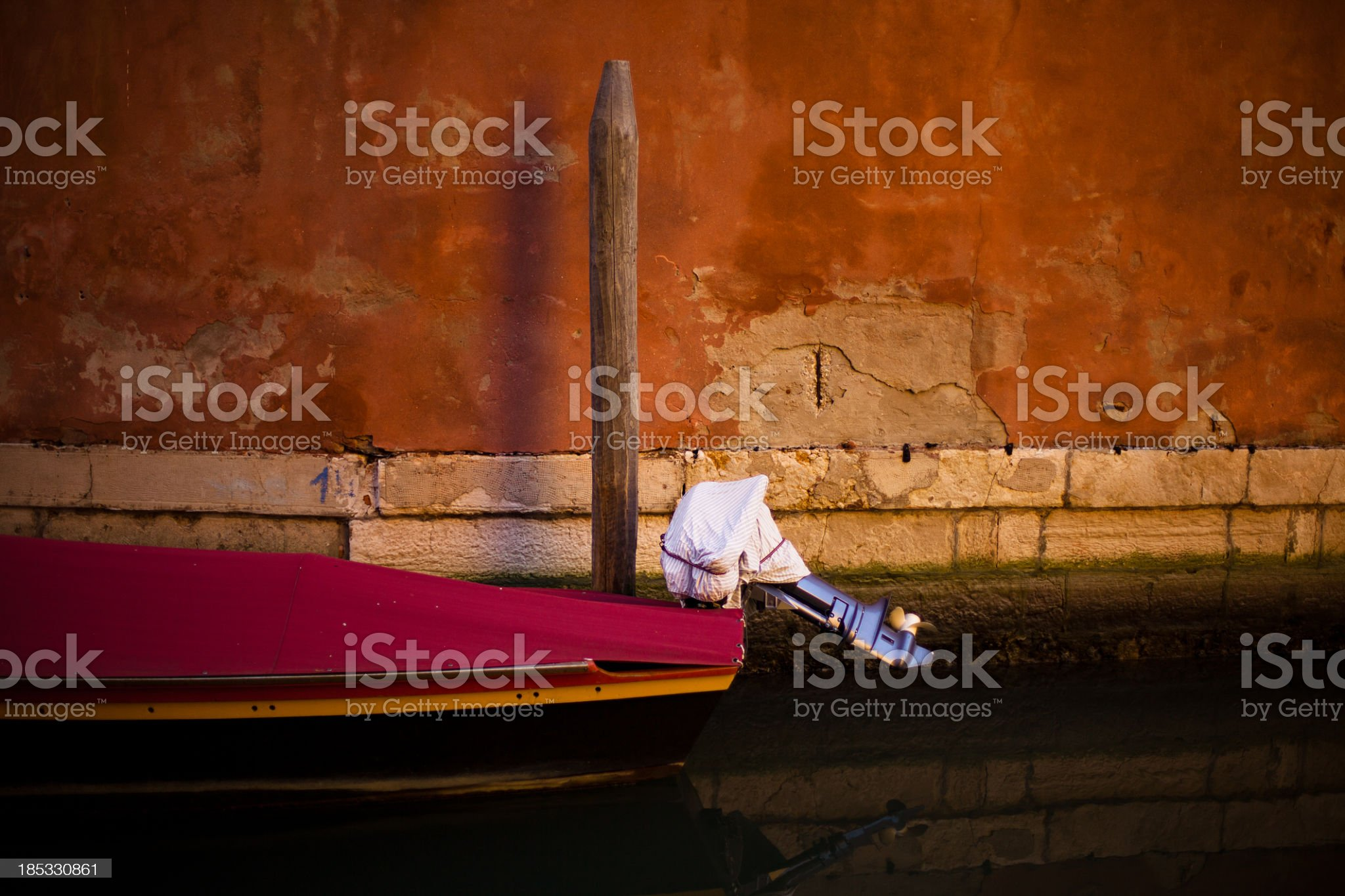 Docked Outboard Motorboat in Venice, Italy royalty-free stock photo