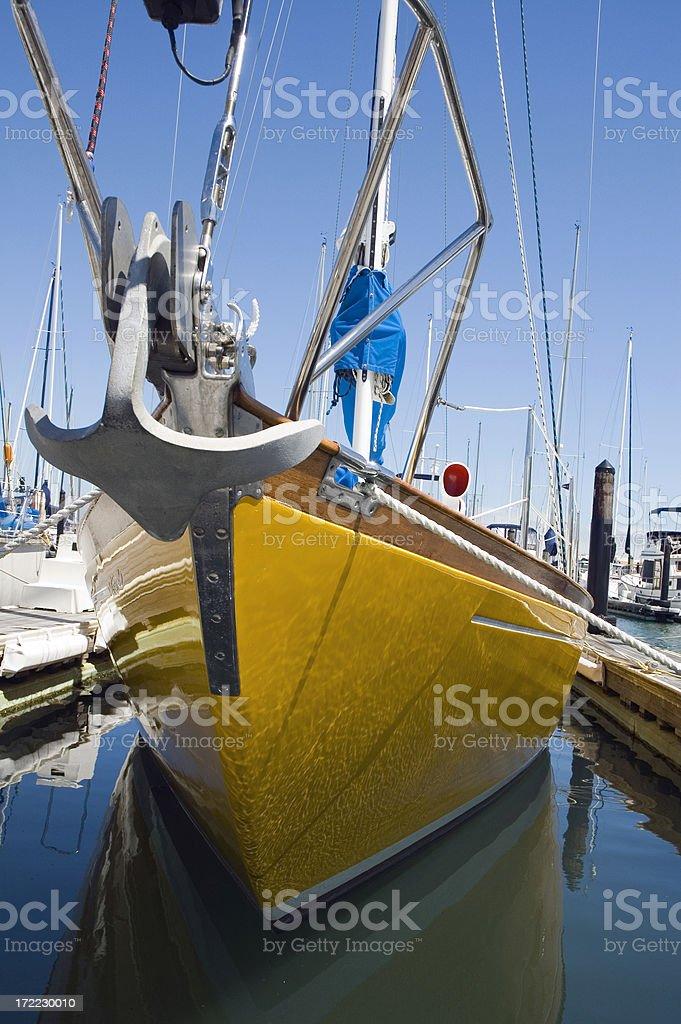 Docked Yellow Sailboat stock photo