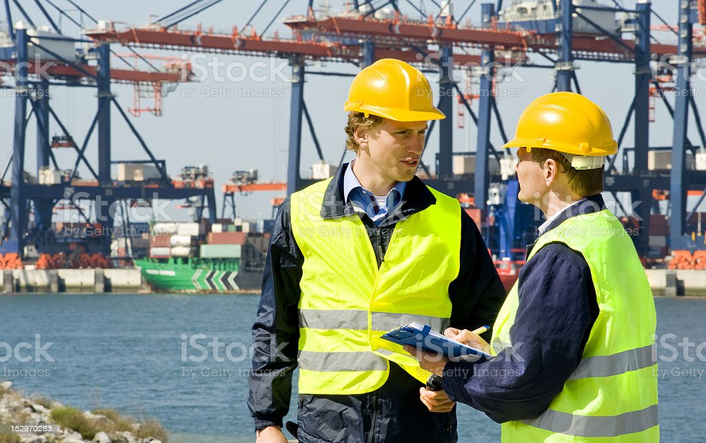 Dockers in a container harbor stock photo