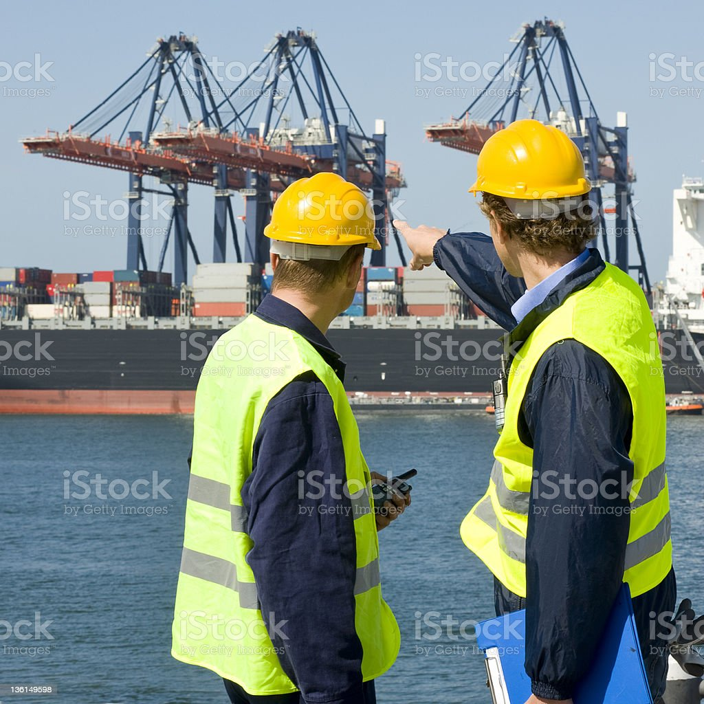 Dockers in discussion stock photo