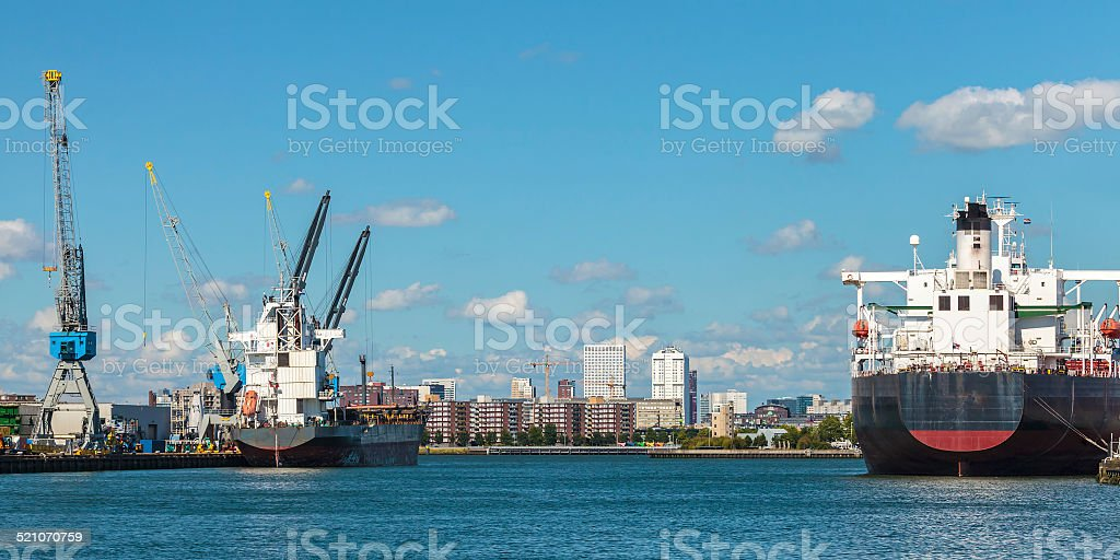 Docking container ships in Rotterdam harbor stock photo
