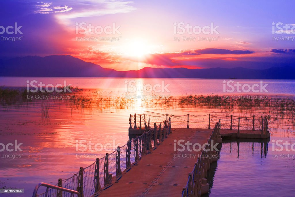 Docks beside lake at sunset. stock photo