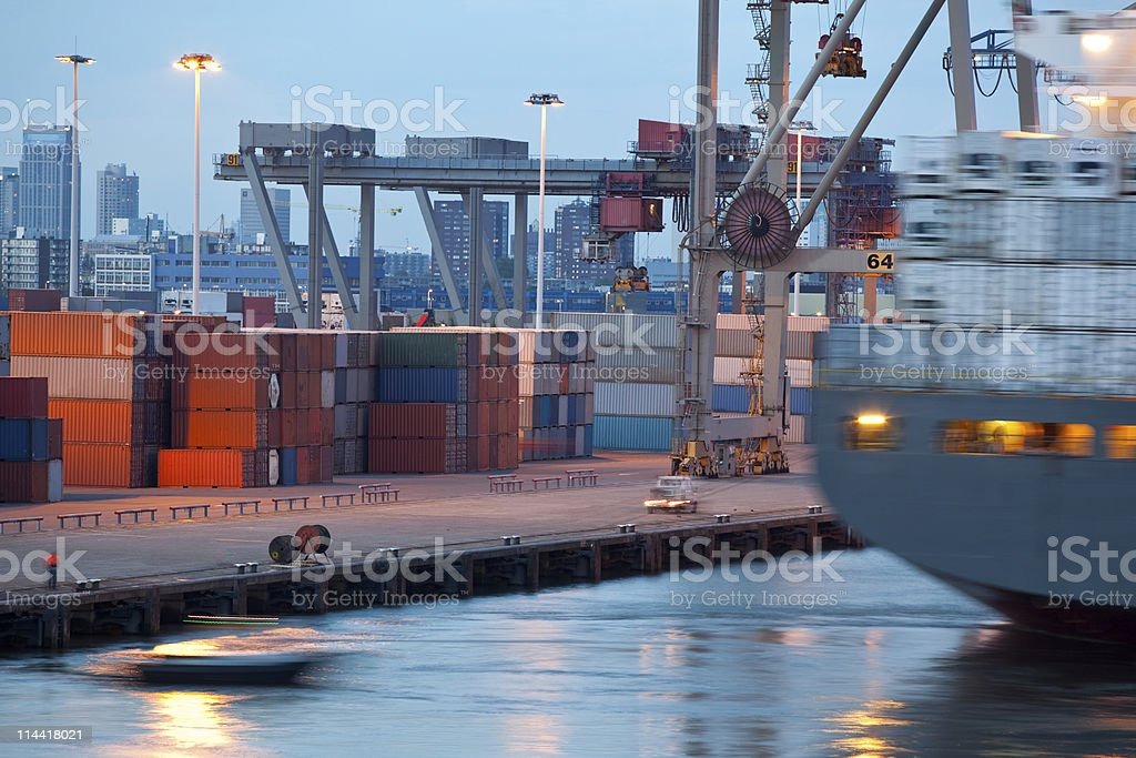 Dockside containing shipping containers and freighter royalty-free stock photo