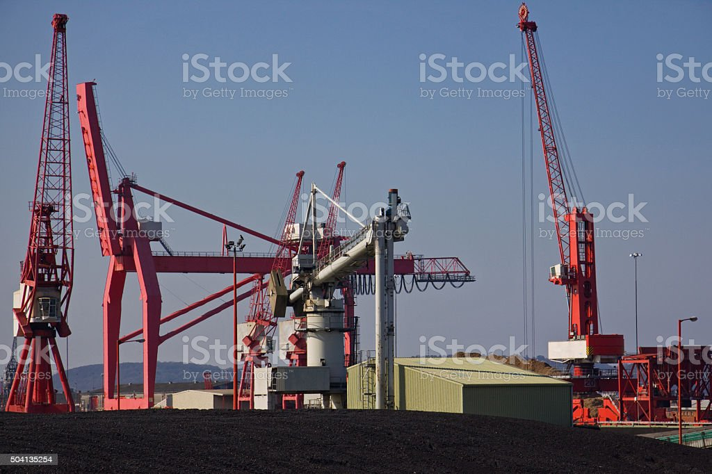 Dockside machinery and imported coal stock at a UK port stock photo