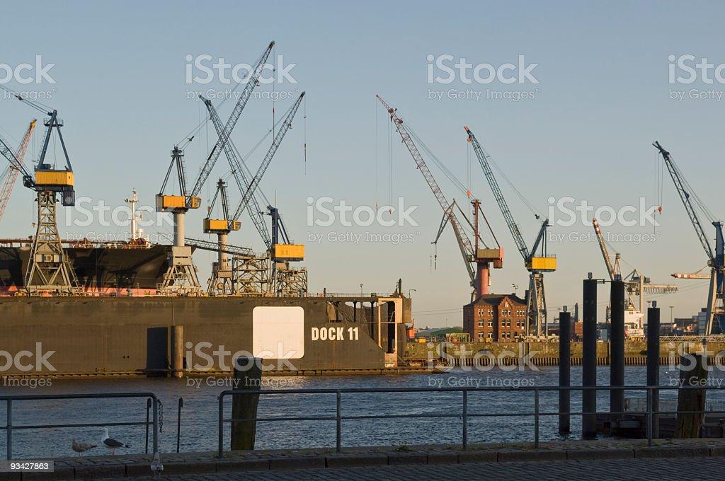 Dockyard with Ship and Cranes at Hamburg Harbor stock photo