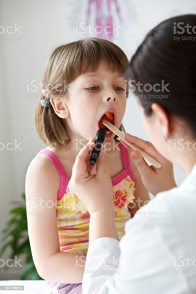 Doctor administering an exam to a child royalty-free stock photo